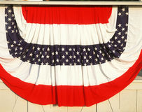 Red White and Blue Bunting. Red, white and blue bunting draped on building Stock Image