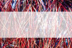 Red white and blue cellophane tinsel strips background with bokeh with semitransparent panel for copy. A Red white and blue cellophane tinsel strips background Stock Photos
