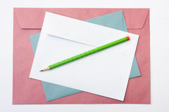 Red white and blue envelope with a wooden pen Stock Images