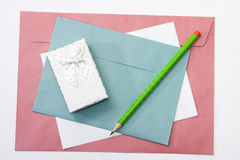 Red white and blue envelopes with a wooden pen and white gift bo Stock Images