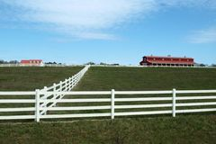 Red, White and Blue. Farm scene in Alabama, USA featuring red barn, white fence and blue sky Royalty Free Stock Photography
