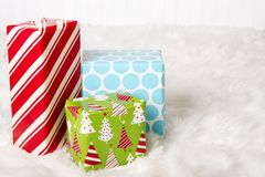 Red, White, Blue and Green Christmas presents stock photo