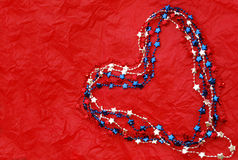 Red White and Blue Heart. Red white and blue necklace heart on red background Stock Images