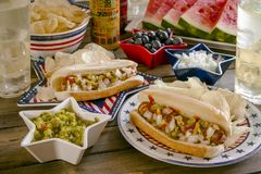 Summer holiday picnic with hot dogs and chips royalty free stock images