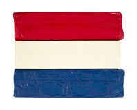 Red white and blue modeling clay. Three blocks of red white and blue modeling clay on a white background Royalty Free Stock Photos