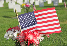 Red White Blue Mum and Daisy Flowers with United States Flag Memorial Day. Red White Blue daisies and mums flower arrangement at cemetery for Memorial Day Royalty Free Stock Photo