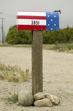 A red, white and blue patriotic U.S. mailbox Royalty Free Stock Image