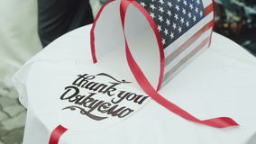 A red, white and blue patriotic U.S. mailbox standing on the table. Bridal money.  stock video