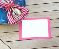 Red White and Blue Picnic Table Place Setting with Blank Card on Rustic Wood Background with room or space for copy, text or your. Words.  A horizontal with a Royalty Free Stock Photos