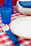 Red, White and Blue Picnic Table Setting Royalty Free Stock Image