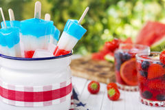 Red-white-and-blue popsicles on an outdoor table Royalty Free Stock Photography