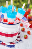 Red-white-and-blue popsicles on an outdoor table Royalty Free Stock Images