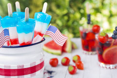Red-white-and-blue popsicles on an outdoor table Royalty Free Stock Image