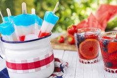 Red-white-and-blue popsicles on an outdoor table Royalty Free Stock Photo
