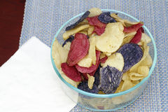 Red, White and Blue Potato Chips. Crunchy appetizer of potato chips made from Crimson red, Purple Majesty and Chipeta, Atlantic potatoes. Potato chips in red stock photos