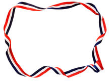 Red white & blue ribbon. Red, white & blue twisted ribbon border stock image