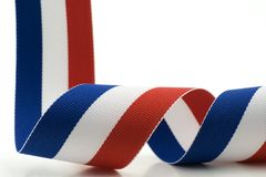 Red, White and Blue Ribbon. Closeup image of a red, white and blue ribbon with a white background stock image