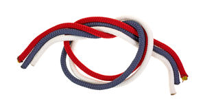 Red white and blue rope tied in loose knot Royalty Free Stock Image