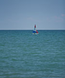 Red, white and blue sailboat Stock Image