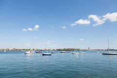 Red White and Blue Sailboats in Boston Harbor Royalty Free Stock Image