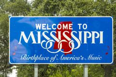 Red, white, and blue sign to welcome travelers to Mississippi -. Birthplace of America`s Music at Chef Menteur Highway royalty free stock photo