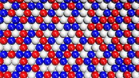 Red, white and blue spheres filling the screen from bottom to top. Red, white and blue shiny spheres forming a background pattern. Computer generated 3D Stock Images