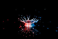 Red White and Blue Splash. On black plexiglas Royalty Free Stock Photo