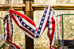 Red, white and blue ribbon at war memorial Royalty Free Stock Photos