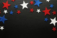 Red, white, and blue stars on dark slate. Red, white, and blue stars on slate background Royalty Free Stock Photo