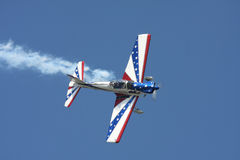 Red, White and Blue stunt plane Royalty Free Stock Photo