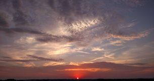 Red white and blue sunset. Vivid sky low horizon, partly cloudy red white and blue sunset Royalty Free Stock Photos