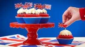 Red white and blue theme cupcakes and cake stand with UK Union Jack flags royalty free stock photo