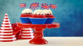 Red white and blue theme cupcakes and cake stand with UK Union Jack flags stock photos