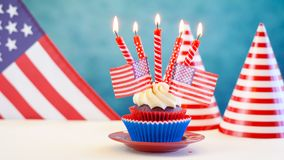 Red white and blue theme cupcakes with USA flags Royalty Free Stock Image