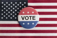 Red, white and blue vote button with US flag. Royalty Free Stock Photos