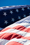 Red White and Blue Waving in the Wind Royalty Free Stock Image