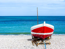 Red-white boat. Ashore, coast of English Channel, Normandy, France stock image