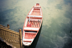 Red and white boat on lake. Stock Photos