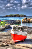 Red and white boat Mullion Cove harbour Cornwall UK in colourful bright HDR Royalty Free Stock Photos