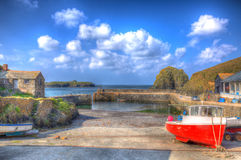 Red and white boat Mullion Cove harbour Cornwall UK in colourful bright HDR Royalty Free Stock Photography