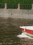 Red and white boat on the water Stock Photography