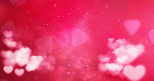 Red and white bokeh heart on pink hearts shape background with particles sparkle glitter, valentine day love holiday event. Festive stock footage