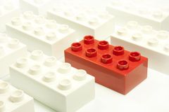 Red and white bricks. Toy bricks of different colors joined together Royalty Free Stock Images