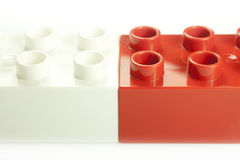 Red and white bricks. Toy bricks of different colors joined together Stock Photography