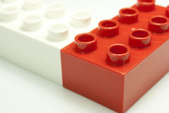 Red and white bricks. Toy bricks of different colors joined together Royalty Free Stock Photography