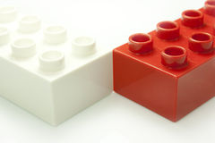 Red and white bricks. Toy bricks of different colors joined together Stock Photos