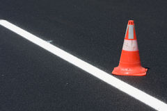 Red white brindled traffic cone Stock Image