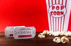 Popcorn With Two Red Movie Tickets. Red and White Bucket Of Popcorn With Two Red Movie Tickets/ Movie Night Close Up On Red stock photos