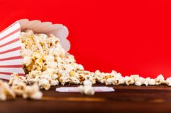 Red and White Bucket Of Popcorn With Two Red Movie Tickets. Movie Night Close Up On Red Royalty Free Stock Images