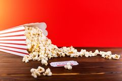 Red and White Bucket Of Popcorn With Two Red Movie Tickets. Movie Night Close Up On Red Royalty Free Stock Photography